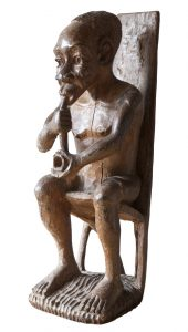 African traditional statuette of old man smoking pipe - Gabon
